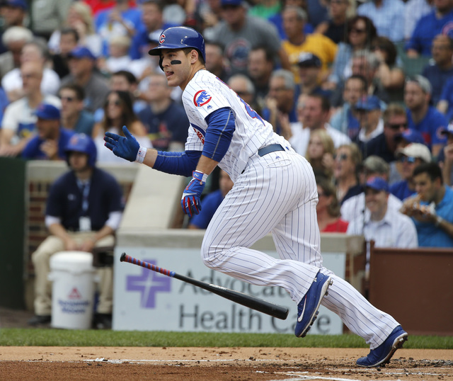 Chicago Cubs' Anthony Rizzo watches his RBI double off St. Louis Cardinals starting pitcher Mike Leake, scoring Kris Bryant, during the first inning of a baseball game Friday, Sept. 23, 2016, in C ...