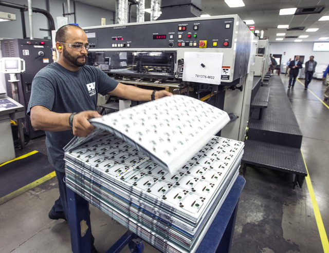 Employee Adan Villegas stacks of gift cards at Plasticard-Locktech International in North Las Vegas on Monday, Oct. 24, 2016. The keycard manufacturer plans to add 50 more employees to its 300-emp ...