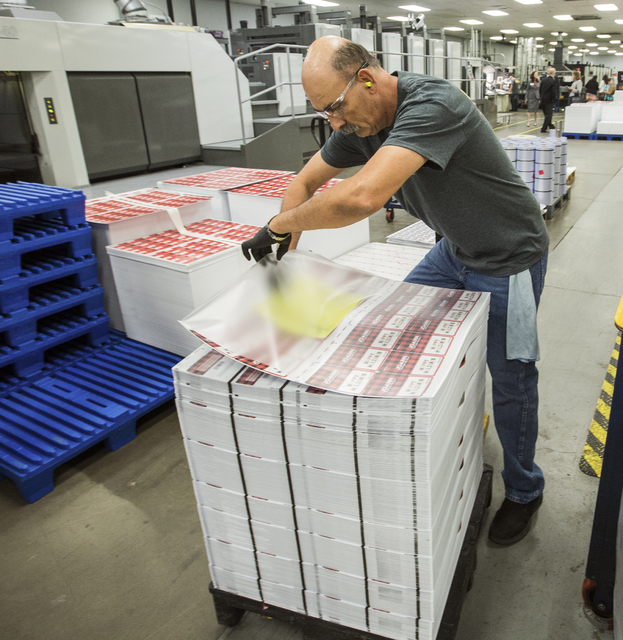 Employee Raul Gonzalez places a packing slip on a order of gift cards at Plasticard-Locktech International in North Las Vegas on Monday, Oct. 24, 2016. The keycard manufacturer plans to add 50 mor ...