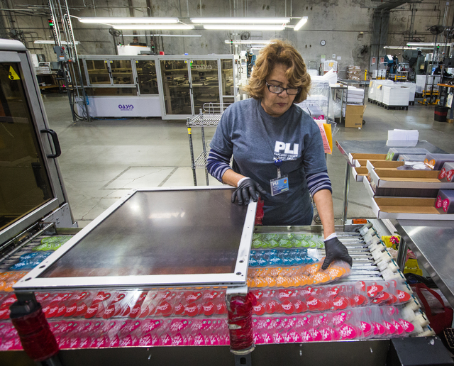 Employee Estaphana Navarro pulls gift cards off a punch line at Plasticard-Locktech International in North Las Vegas on Monday, Oct. 24, 2016. The manufacturer plans to add 50 more employees to it ...