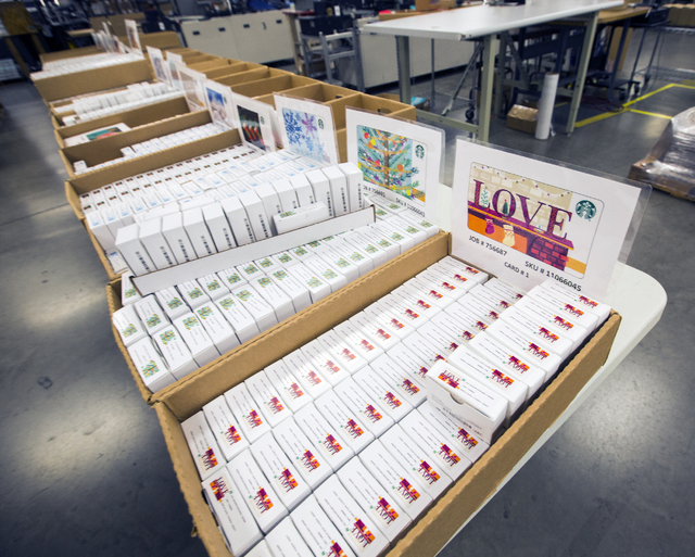 Boxes of gift cards sit on a table at Plasticard-Locktech International in North Las Vegas on Monday, Oct. 24, 2016. The keycard manufacturer plans to add 50 more employees to its 300-employee wor ...