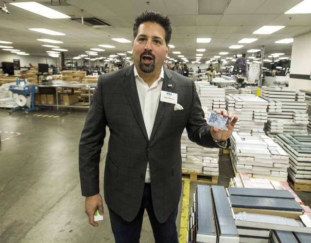 Plasticard-Locktech International president and CEO Peter Krauss holds a gift card at the company's  North Las Vegas facility on Monday, Oct. 24, 2016. The keycard manufacturer plans to add 50 mor ...