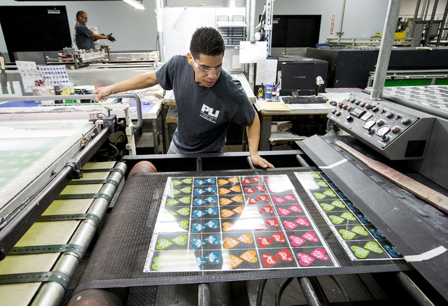 Employee views gift cards printing on a silk screen press at Plasticard-Locktech International in North Las Vegas on Monday, Oct. 24, 2016. The keycard manufacturer plans to add 50 more employees  ...