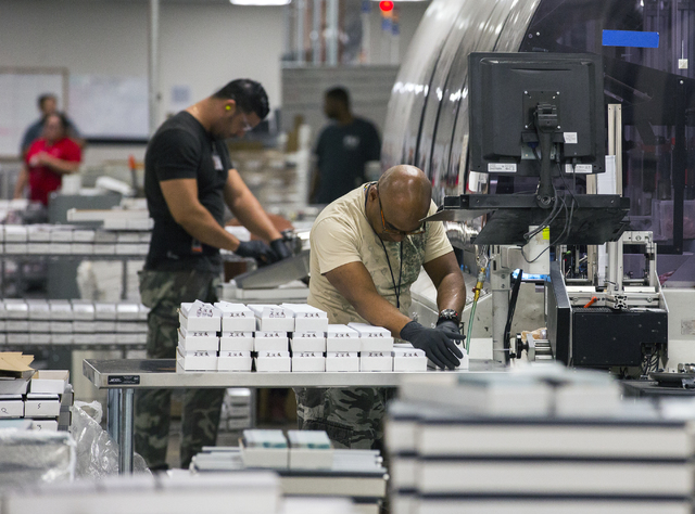 Employees pack gift cards at Plasticard-Locktech International in North Las Vegas on Monday, Oct. 24, 2016. The keycard manufacturer plans to add 50 more employees to its 300-employee workforce. ( ...