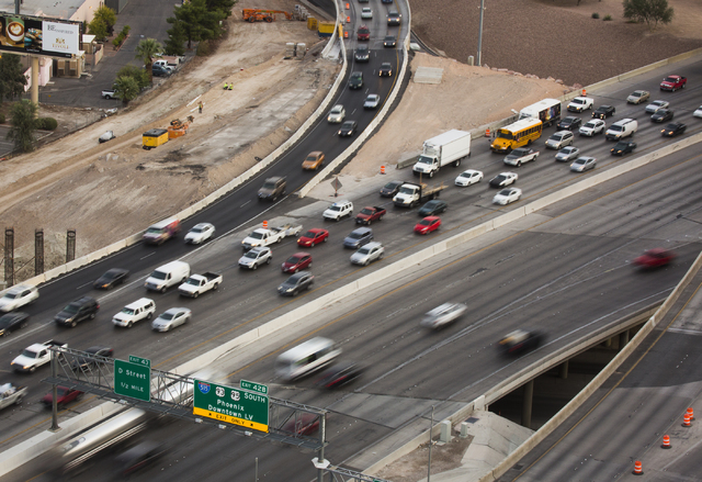 """Morning traffic flows through the """"Spaghetti Bowl"""", seen from the top of the World Market Center, on Thursday, Oct. 27, 2016. Interstate 15 southbound and northbound ramps connecting to northbound ..."""