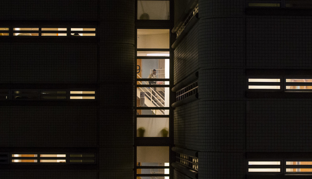 An officer walks down stairs at the Clark County Detention Center in downtown Las Vegas on Tuesday, Oct. 11, 2016. (Chase Stevens/Las Vegas Review-Journal Follow @csstevensphoto)
