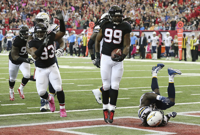 Atlanta Falcons defensive end Adrian Clayborn recovers a fumble by San Diego Chargers quarterback Philip Rivers on a sack by Vic Beasley Jr. and returns it for a touchdown during the second quarte ...