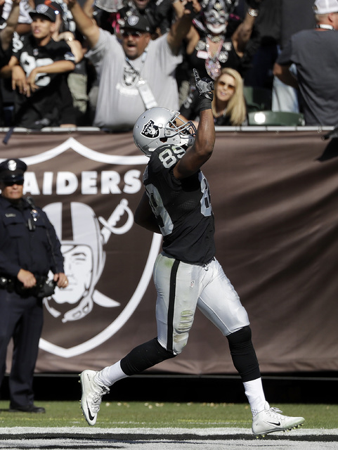 Oakland Raiders wide receiver Amari Cooper (89) celebrates after catching a touchdown pass during the second half of an NFL football game against the San Diego Chargers in Oakland, Calif., Sunday, ...