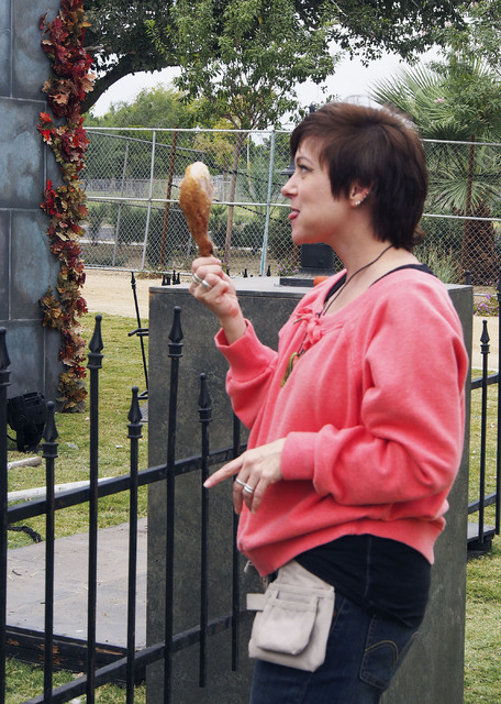 "Traci Parsons munches on a turkey leg as she watches work going on at the Greenwood Revellers ""castle"" at the Age of Chivalry in Sunset Park in Las Vegas Oct. 9, 2013. View file photo"