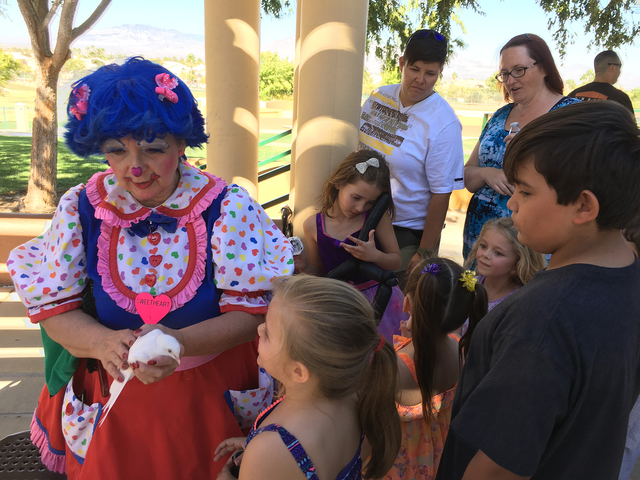 Clown and magician Cindy Mallette makes balloon animals at a birthday party. (John Przybys/Las Vegas Review-Journal)