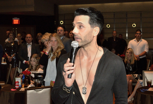 Magician Criss Angel speaks after bidding $100,000 for a sculpture and donating $200,000 to two cancer charities during the Circus Couture ҌuckyӠfundraising event benefitting the Child ...