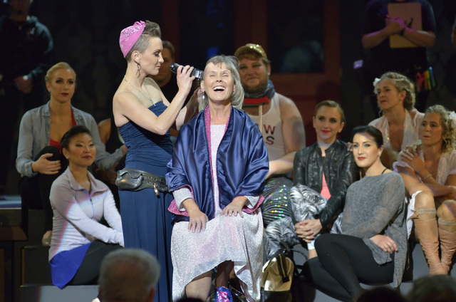 "Erica Linz, left, shaves her mother Mary-Mike Linz's head during a ceremony to show solidarity with cancer patients at the Circus Couture ""Lucky"" fundraiser at the Hard Rock h ..."