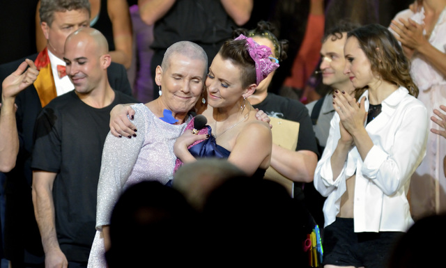 "Erica Linz, right, hugs her mother Mary-Mike Linz after Erica shaved Mary-Mike's head during a ceremony to show solidarity with cancer patients at the Circus Couture ""Lucky"" f ..."
