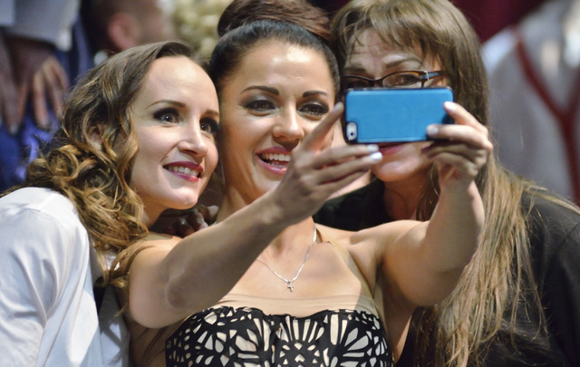 Natalia Shaenko, from left, Angelina Puzanova and Svetlana Walden take a selfie backstage after participating in the Circus Couture ҌuckyӠfundraiser benefitting the Childrenճ Spe ...