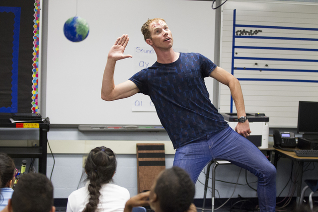 "Cirque du Soleil's Benedikt Negro, a mime in ""O,"" teaches students about igneous rocks during his visit to McCall Elementary School in North Las Vegas as part of Cirque's new Arts Nomades program. ..."