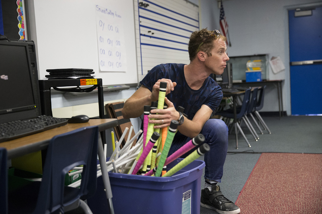 Teaching artist Benedikt Negro prepares to pass out devil sticks for a juggling session with McCall Elementary School fourth-graders as part of Cirque du Soleil's weekly Arts Nomades program. Erik ...