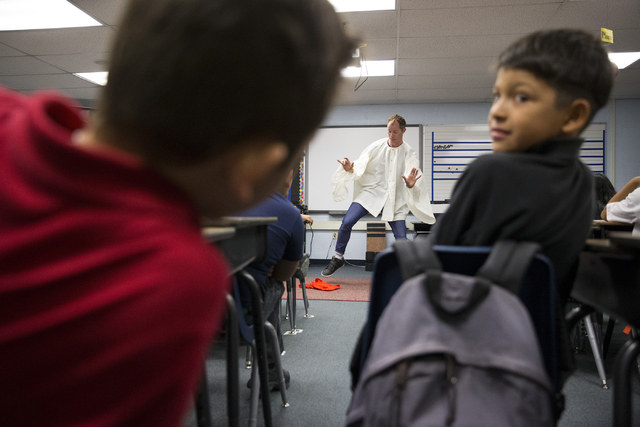 Fourth-graders at McCall Elementary School observe teaching artist Benedikt Negro's dance about volcanic rocks during his weekly visit as part of Cirque du Soleil's new Arts Nomades program. Erik  ...