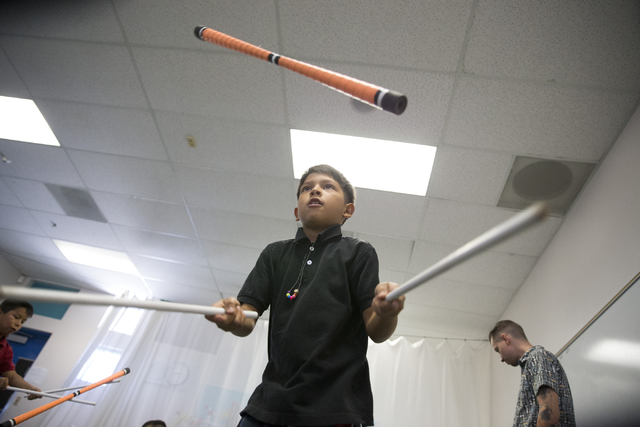 Fourth-grader Jose Romo, 8, joins McCall Elementary School classmates in flipping devil sticks as part of a Cirque du Soleil's new Arts Nomades program. Erik Verduzco/Las Vegas Review-Journal Foll ...