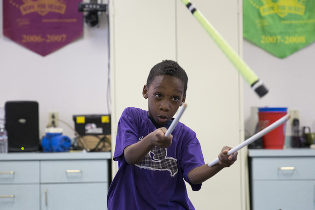 Fourth-grader Day' Jure Jean, 8, practices flipping devil sticks during a weekly Arts Nomades session taught by a Cirque du Soleil performer at McCall Elementary School. Erik Verduzco/Las Vegas Re ...