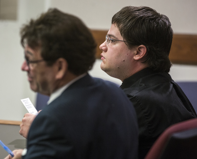 Daron Lewis Clanton, right, who is accused in the shooting death of his father, sits with his attorney Mace J. Yampolsky during his preliminary hearing in Henderson Justice Court on Monday, Oct.10 ...