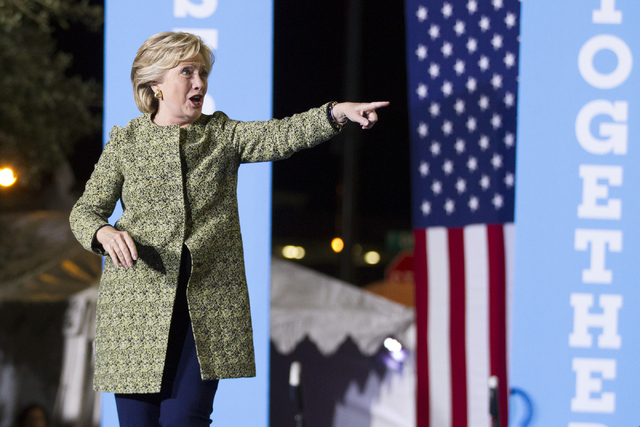 Democratic presidential nominee Hillary Clinton takes the stage during a campaign rally at the Smith Center for the Performing Arts on Wednesday, Oct. 12, 2016, in Las Vegas. Erik Verduzco/Las Veg ...
