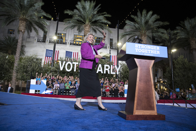 U.S. Rep. Dina Titus, D-Nev., takes the stage during a campaign rally for Democratic presidential nominee Hillary Clinton at the Smith Center for the Performing Arts on Wednesday, Oct. 12, 2016, i ...