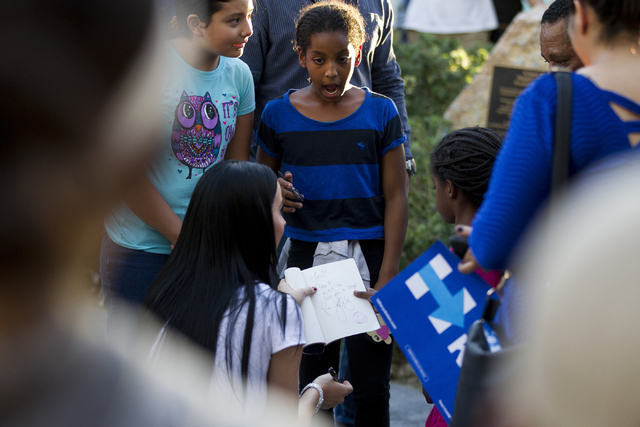 Music artist Katy Perry signs an autograph for a girl after speaking during a campaign rally for Democratic presidential nominee Hillary Clinton at UNLV on Saturday, Oct. 22, 2016, in Las Vegas. E ...
