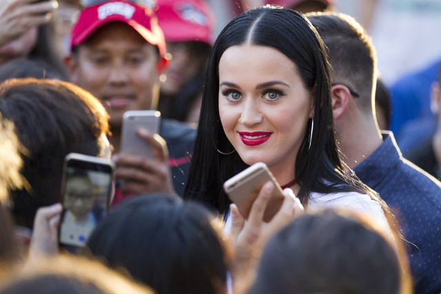 Music artist Katy Perry poses with fans after speaking during a campaign rally for Democratic presidential nominee Hillary Clinton at UNLV on Saturday, Oct. 22, 2016, in Las Vegas. Erik Verduzco/L ...