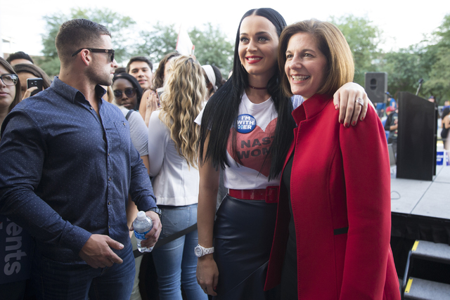Music artist Katy Perry poses with Democratic U.S. Senate candidate Catherine Cortez Masto during a campaign rally for Democratic presidential nominee Hillary Clinton at UNLV on Saturday, Oct. 22, ...