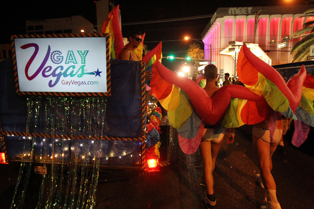 Members of the GayVegas.com entry march in the 16th Annual Las Vegas PRIDE Night Parade in downtown Las Vegas Friday, Sept. 5, 2014. The event supports the lesbian, gay, bisexual and transgender c ...
