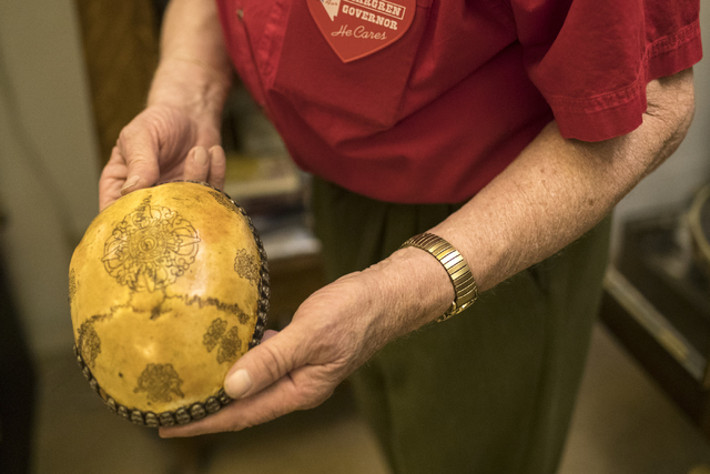 Former Lt. Gov. Lonnie Hammargren holds up a human skull that was made into a decorative box during his 21st annual open house on Saturday, Oct. 29, 2016. Loren Townsley/Las Vegas Review-Journal F ...