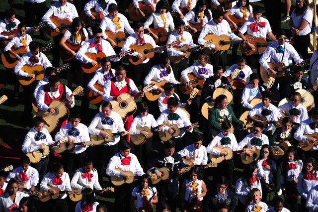 Nearly 730 CCSD mariachi musician students attempt to set world record for the largest amount of mariachis performing simultaneously before the start of an NCAA college football game between Color ...