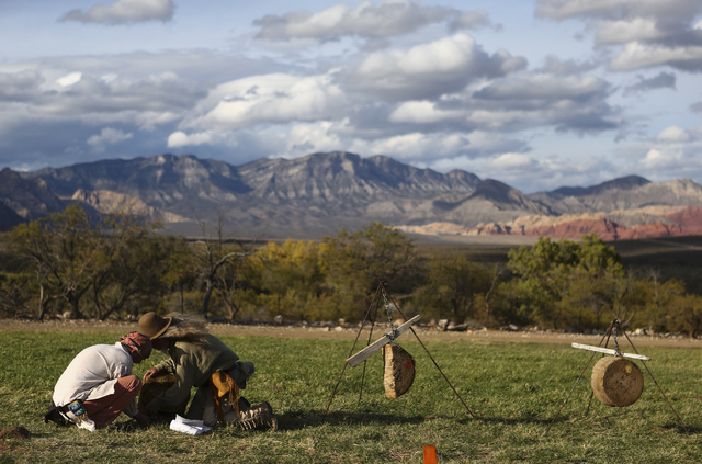 Mike Alley, left, and John McKay fix a target that was damaged during the Spring Mountain Free Trappers Mountain Man Rendezvous at Spring Mountain Ranch State Park on Saturday, Oct. 29, 2016. Chas ...