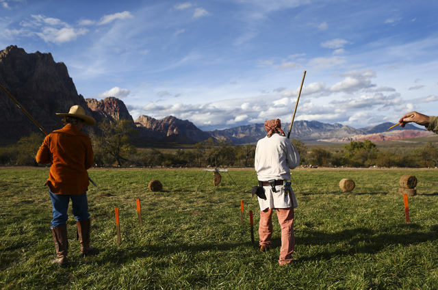 Jack Leas, left, and Mike Alley prepare to throw lances during the Spring Mountain Free Trappers Mountain Man Rendezvous at Spring Mountain Ranch State Park on Saturday, Oct. 29, 2016. Chase Steve ...