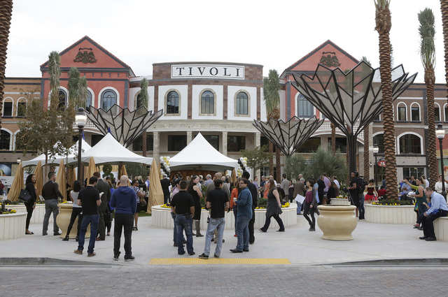 Invitees gather to attend the ribbon-cutting for the opening of Tivoli Village's second phase Friday, Oct. 28, 2016, in Las Vegas. The second phase added more than 270,000 square feet of retail, r ...