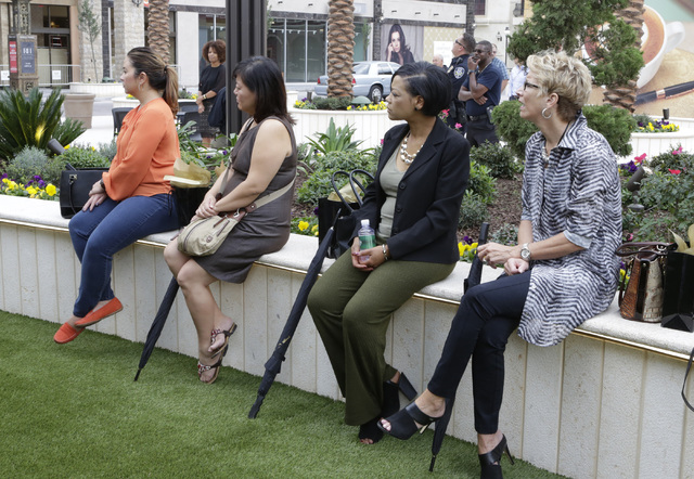 Invitees watch the ribbon-cutting for the opening of Tivoli Village's second phase Friday, Oct. 28, 2016, in Las Vegas. The second phase added more than 270,000 square feet of retail, restaurant,  ...