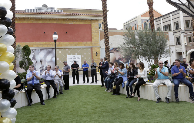 Invitees applaud during the ribbon-cutting for the opening of Tivoli Village's second phase Friday, Oct. 28, 2016, in Las Vegas. The second phase added more than 270,000 square feet of retail, res ...