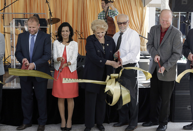 Noam Ziu, CEO, IDB Group USA, left, Segi Eithan, Mayor Carolyn Goodman, center, Pat Henderson, president of Hardstone Construction, and Bob Beers, Las Vegas City Councilman, right, participate in  ...