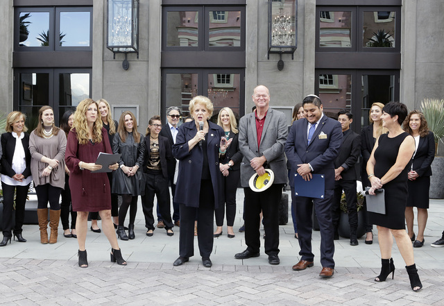 Nicole Drake, vice president field leader at RH, left, Bob Beers, Las Vegas City Councilman, center, and Umram Osambela, second right, listen as Mayor Carolyn Goodman speaks during the opening cer ...