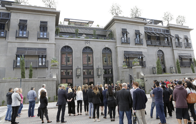 Invitees gather to attend the opening ceremony of Restoration Hardware's first Nevada location at Tivoli Village Friday, Oct. 28, 2016, in Las Vegas. Restoration Hardware's store is called RH Las  ...