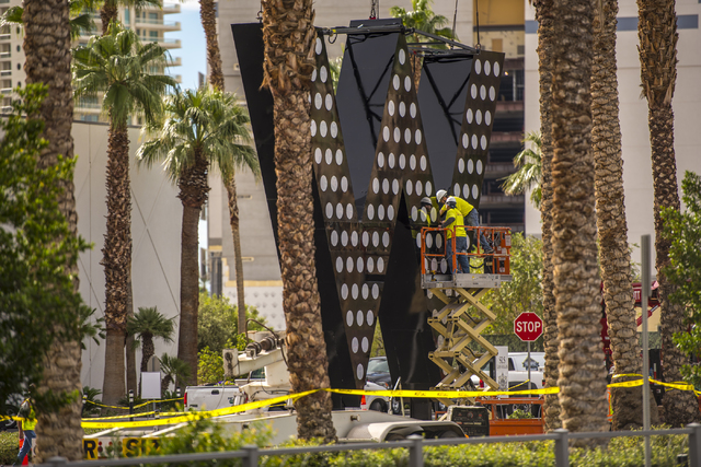 Workers prepare the sign for the new W Hotel is seen at the SLS hotel-casino in Las Vegas on Friday, Oct. 14, 2016. Joshua Dahl/Las Vegas Review-Journal