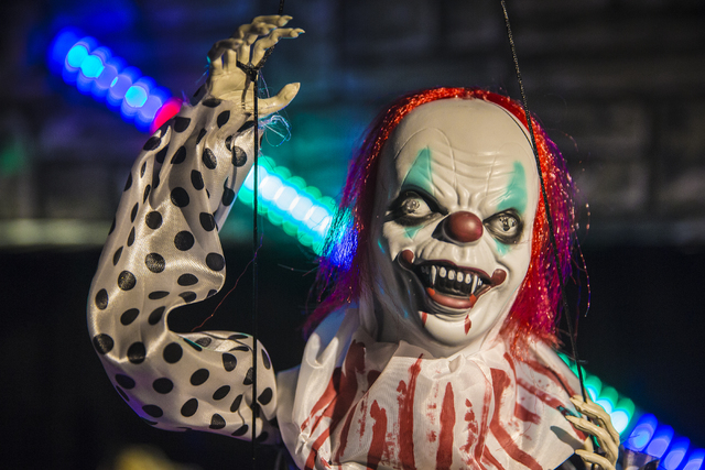 A killer clown hangs from the ceiling at Halloween Mart last month in Las Vegas. (Benjamin Hager/Las Vegas Review-Journal)
