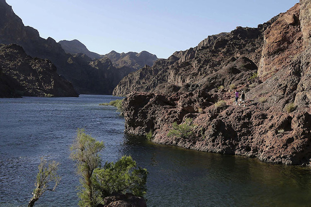 Hikers make their way along the banks of the Colorado River near Willow Beach, Ariz., in 2013. (Julie Jacobson/The Associated Press)