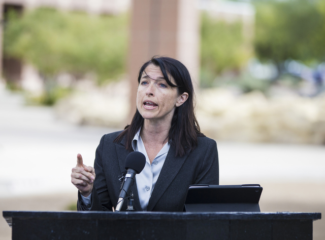 Laura Granier, council for the Nevada Connections Academy, announces the charter schools intention to take legal action against the Nevada State Charter School Authority, during a press conference ...