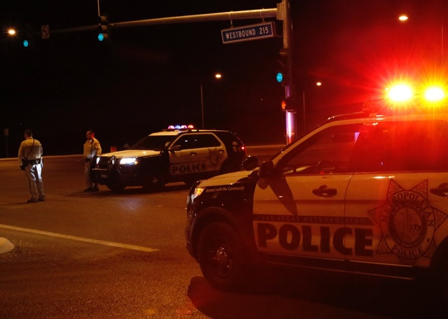 The onramp to westbound 215 Beltway near North Hualapai Way is blocked early Thursday, Oct. 13, 2016, after Las Vegas police shot and killed a man they think was involved in a string of robberies  ...