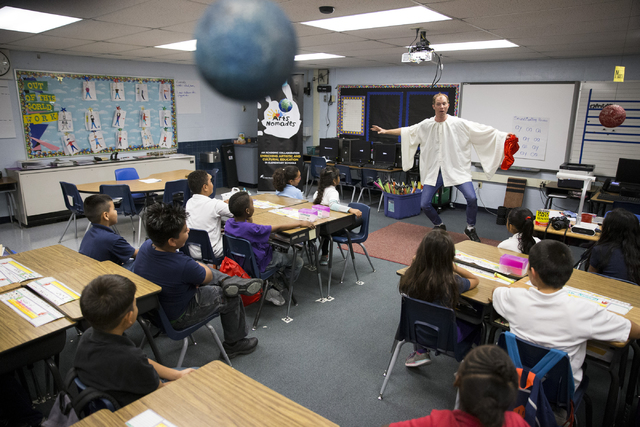Cirque to Soleil mime Benedikt Negro dances for students at McCall Elementary School in North Las Vegas, helping them learn about geology as part of Cirque's new Arts Nomades program. Erik Verduzc ...