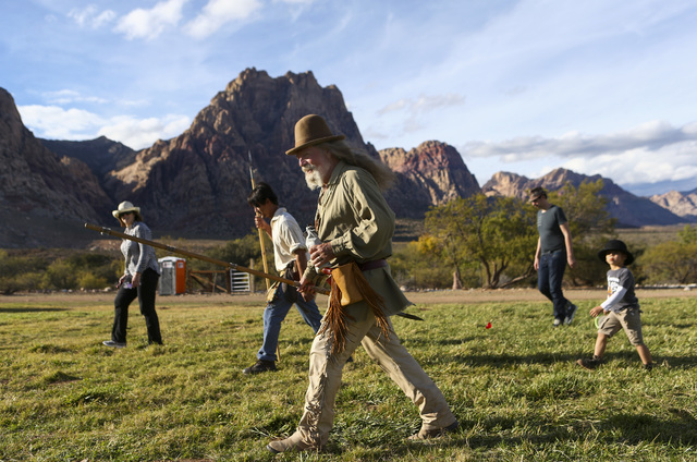 John McKey of Indian Springs, center, participates during the Spring Mountain Free Trappers Mountain Man Rendezvous at Spring Mountain Ranch State Park on Saturday, Oct. 29, 2016. Chase Stevens/La ...
