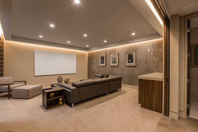 The home theater has a modern design. (Courtesy)