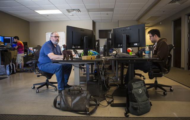 Architect Yo Sub Kwon, from left, Senior Engineer Adam Englander and Android Developer Armando Smith, work at their desks at LaunchKey, a Las Vegas-based technology company that was recently acqui ...