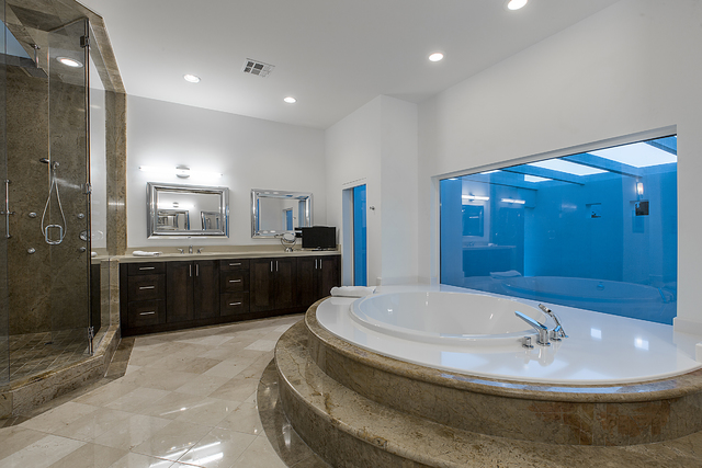 The master bath of Dr. Lionel Handler's home in Tournament Hills.